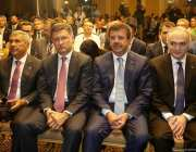Turkish Economy Minister Nihat Zeybekci (right 2), Turkish Minister of Science, Industry and Technology, Faruk Ozlu (R), President of Tatarstan, Rustam Minnikhanov (L) and Russian Energy Minister Alexander Novak (left 2) attend Turkey-Russia business forum in Izmir, Turkey on 18 August, 2017 [Cem Öksüz/Anadolu Agency]