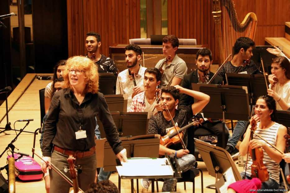 Mostafa Saad, centre, rehearsing with the Palestine Youth Orchestra in 2016 in London [Jehan Alfarra/Middle East Monitor]