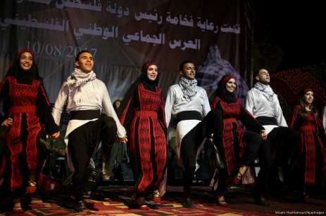 Palestinians perform Dabka, a traditional Palestinian dance, during a mass wedding ceremony in Nablus, West Bank on 10 August 2017 [Ayman Ameen/Apaimages]