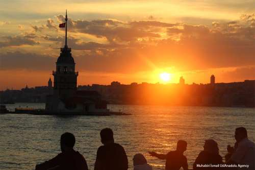 ISTANBUL - People watch Maiden's Tower view at the Salacak beach seaside during the sunset on a hot summer day