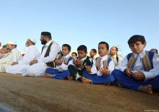 Muslims gather to perform the Eid Al-Adha prayer at Martyrs Square in Tripoli, Libya on September 01, 2017. ( Hazem Turkia - Anadolu Agency )