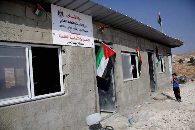 After Israeli forces demolishes the school in Bethlehem district of West Bank, the school was re-opened by the Palestinian Ministry of Education following reconstruction work done by activists [Mamoun Wazwaz/Anadolu Agency]