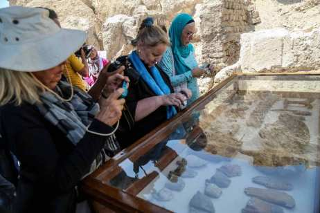 Visitors take a photos of ancient wooden statues that found in a tomb of a goldsmith named Amenemhat from the time of Tutankhamun in Luxor, Egypt on 9 September 2017 [Ibrahim Ramadan/Anadolu Agency]