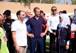 President of UEFA Aleksander Ceferin (4th R), West Asian Football Federation President and Jordan Football Federation President, Prince Ali bin al-Hussein (3rd R) and UNHCR Representative for Jordan Stefano Severe (2nd L), former French footballer Christian Karembeu (3rd L) and Swiss footballer Lara Dickenmann (4th L) pose for a photo with children during the opening ceremony of a football field at Zaatari refugee camp which is located at the east of the city of Mafraq, Jordan on 12 September, 2017 [Stringer/Anadolu Agency]