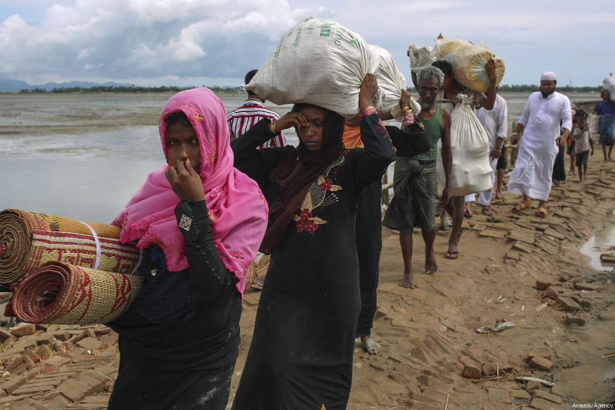 Rohingya Muslims, fled from ongoing military operations in Myanmar's Rakhine state, walk to a makeshift camp on hills at Cox's Bazar, Bangladesh on September 17, 2017 [Zakir Hossain Chowdhury / Anadolu Agency]
