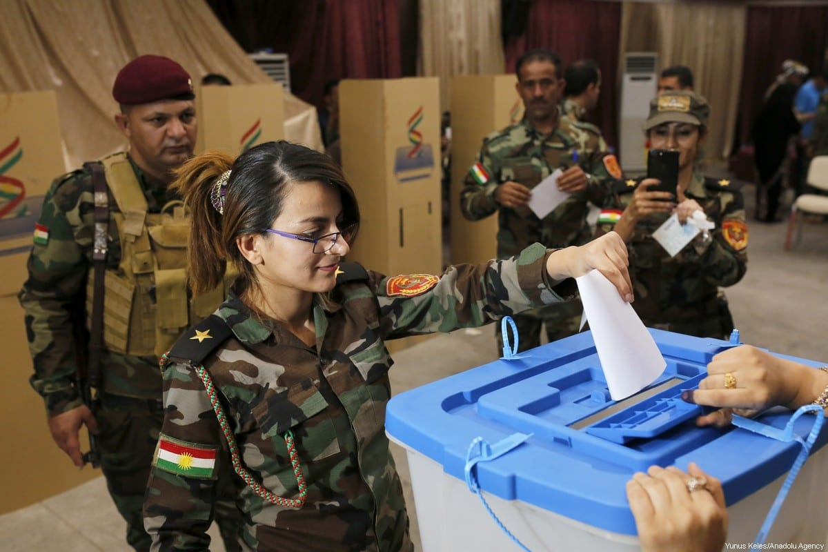 A soldier with the Kurdish Peshmerga force casts her ballot in the Kurdish Regional Government (KRG) controversial referendum at a military polling station in Rashkin village of Erbil, Iraq on September 25, 2017 [Yunus Keleş / Anadolu Agency]