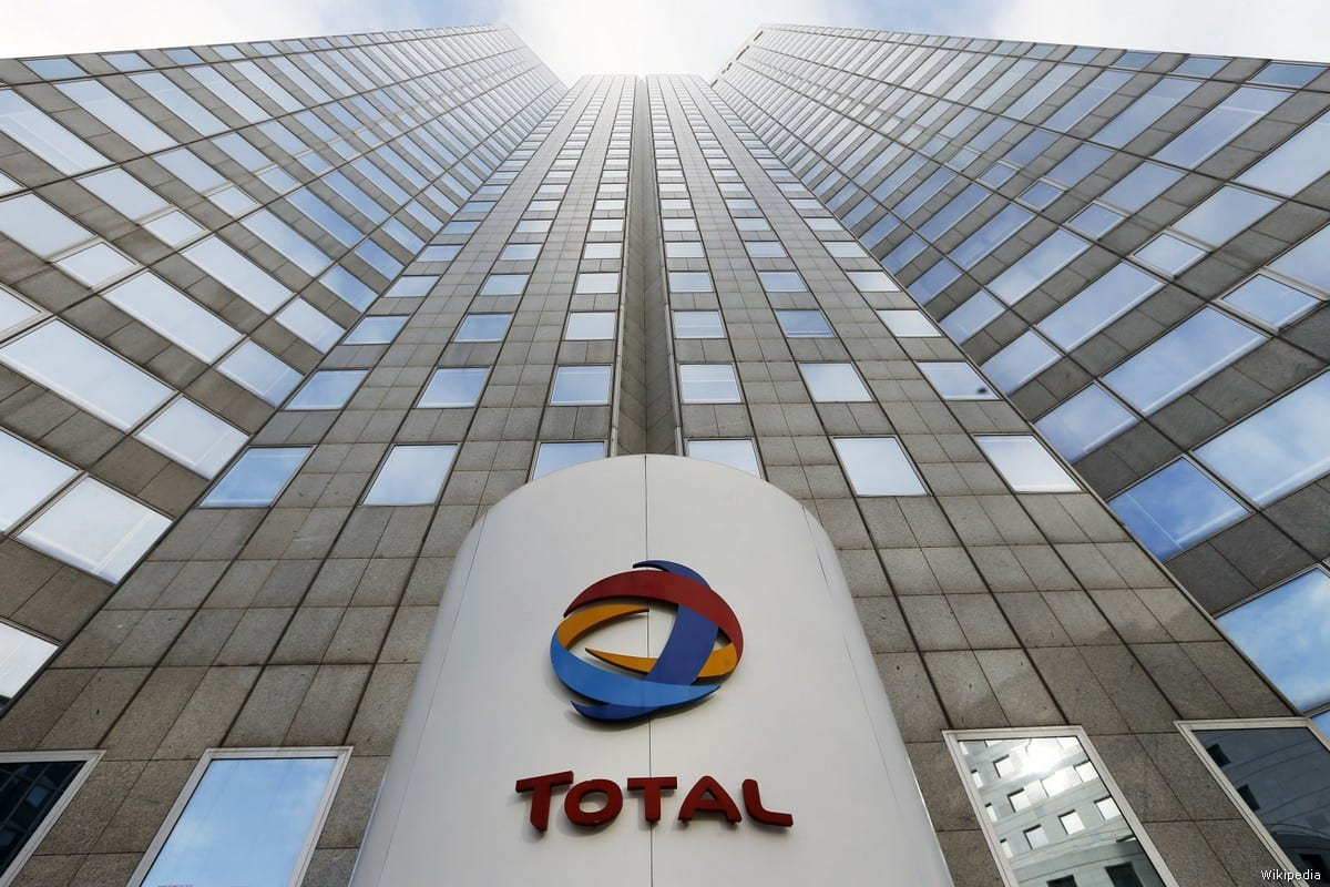 The logo of the French oil giant Total SA is seen at the entrance of the company headquarters in the La Defense business district, west of Paris on 5 February, 2013 [Wikipedia]