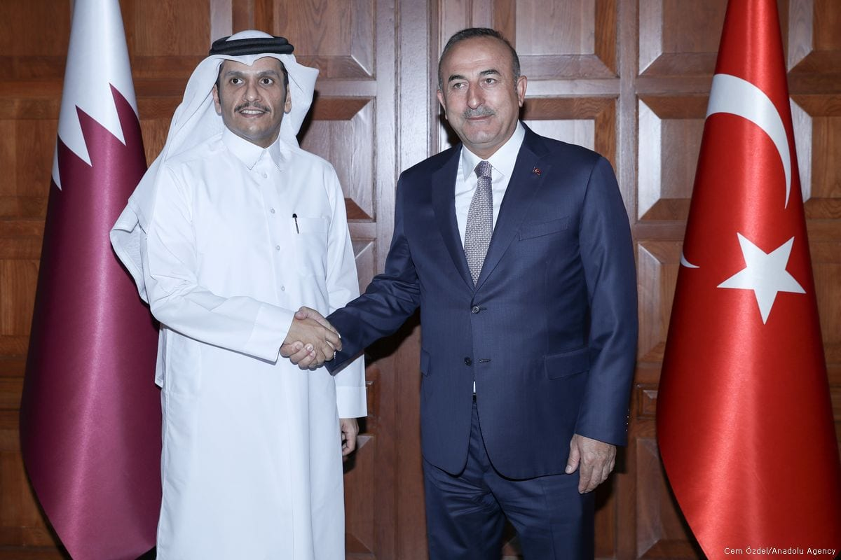 Foreign Affairs Minister of Turkey Mevlut Cavusoglu (R) and Foreign Affairs Minister of Qatar Mohammed bin Abdulrahman Al-Thani pose for a photo in Ankara, Turkey on 12 September 2017 [Cem Özdel/Anadolu Agency]