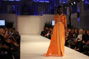 Spectators enjoy Moroccan dresses on the catwalk at London Fashion Week! [Jehan Alfarra/Middle East Monitor]
