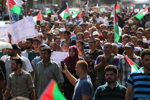General labourers, fishermen and farmers gather to call for a successful Fatah-Hamas reconciliation, on September 24, 2017 in Gaza [Mohammad Asad / Middle East Monitor]