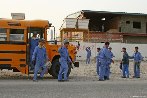Construction workers in Doha, Qatar [Richard Messenger/Flickr]
