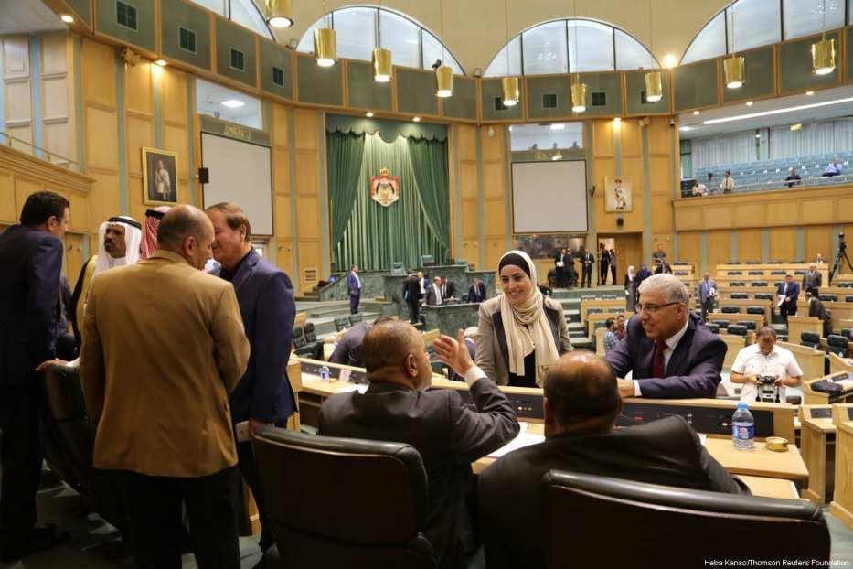 Jordanian MP Wafaa Bani Mustafa talks to fellow MPs, Jordanian parliament, Amman, Jordan, 6 August 2017. [Thomson Reuters Foundation/Heba Kanso]
