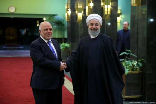 Iraqi Prime Minister Haider al-Abadi (L) and Iranian President Hassan Rouhani [Iranian Presidency/ Anadolu Agency]