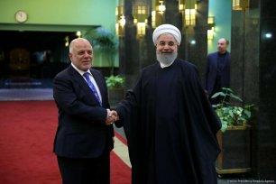 Iraqi Prime Minister Haider al-Abadi (L) and Iranian President Hassan Rouhani [Iranian Presidency/ Anadolu Agency]