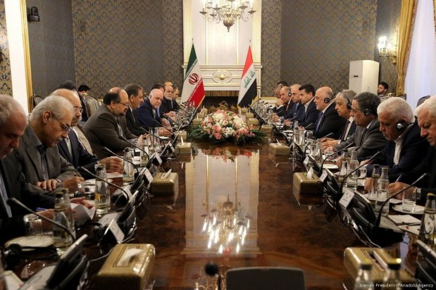 Iran's First Vice President Eshaq Jahangiri (5th L) and Iraqi Prime Minister Haider al-Abadi (5th R) attend inter-delegations meeting in Tehran Iran on 26 October 2017 [Iranian Presidency/Anadolu Agency]