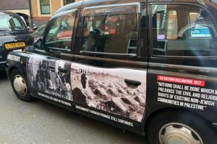 Anti-Balfour ad campaign, which was banned by Transport For London, are seen on London's black cabs