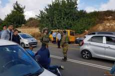 Palestinians help a wounded man after Israeli occupation forces shot him and his sister in the West Bank [Alkhaleejonline.net]