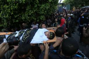 Procession and funeral for the seven Palestinians killed in an Israeli attack on a tunnel in the Gaza Strip on 30 October 2017 [Mohammed Asad/Middle East Monitor]