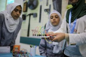 Children take park in experiments as part of the Days of Science in Palestine 2017 exhibition in Gaza City on 17 October 2017 [Ali Jadallah/Anadolu Agency]