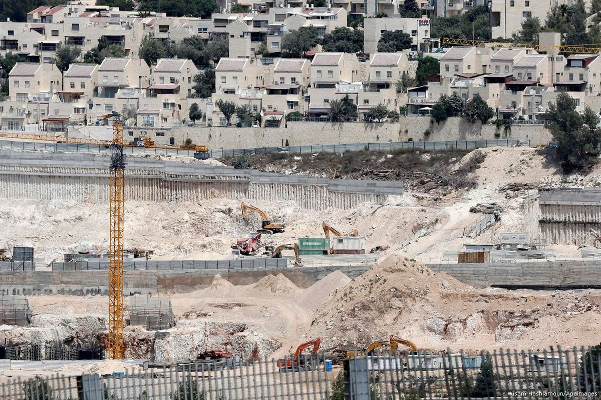 Construction workers build illegal settlements in West Bank [File photo, Wisam Hashlamoun/Apaimages]