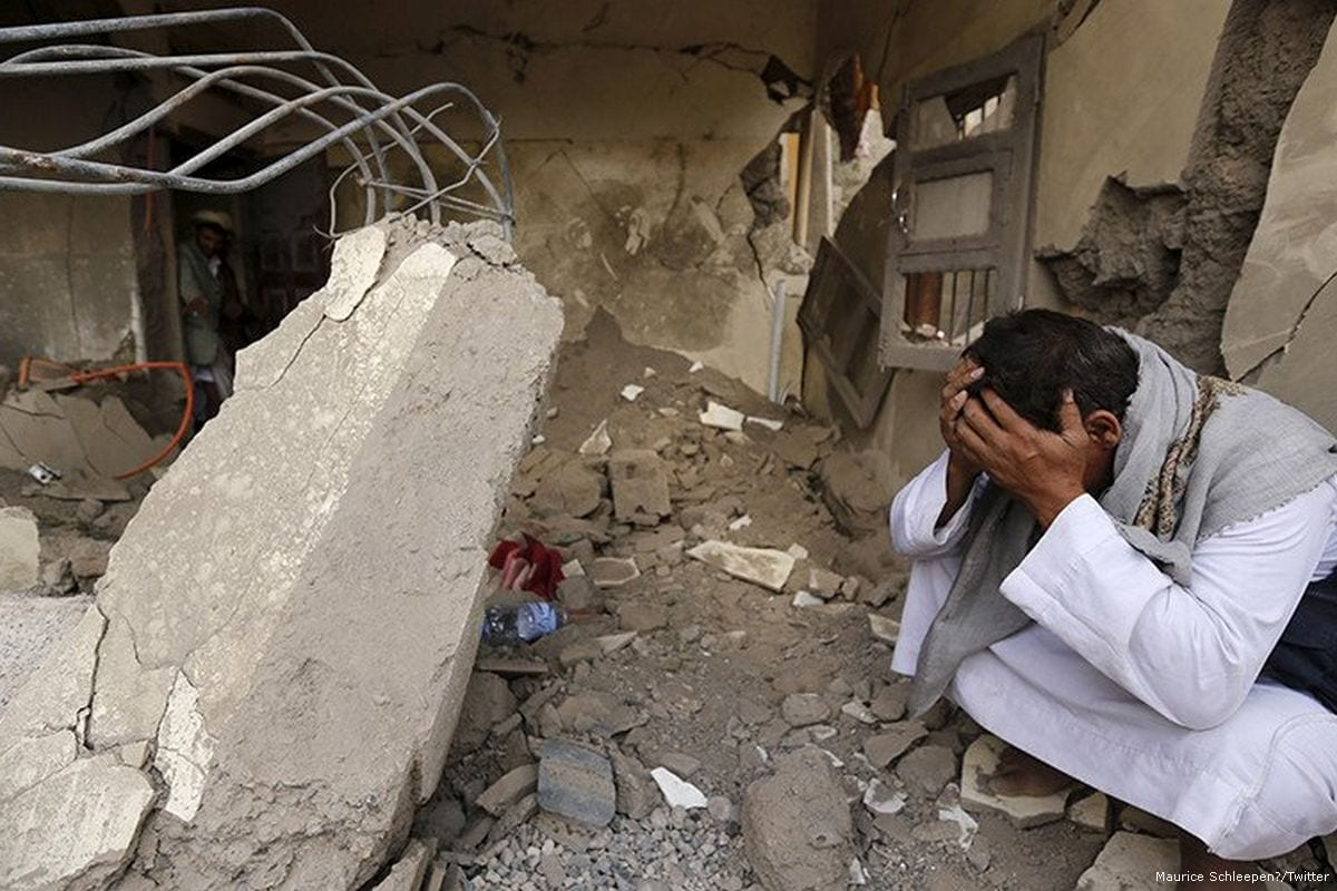 A Yemeni man in despair after the Saudi-led coalition destroyed his home on 20 September 2017 [Maurice Schleepen‏/Twitter]