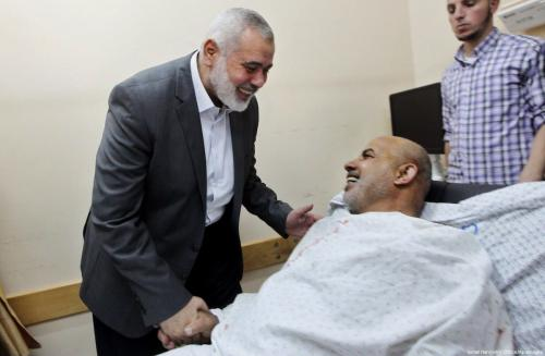 Hamas Chief Ismail Haniyeh visits Tawfiq Abu Naim, director general of the internal security forces, at a hospital in Gaza City after he survived an assassination attempt on 27 October 2017. [Ismail Haniyeh's office]