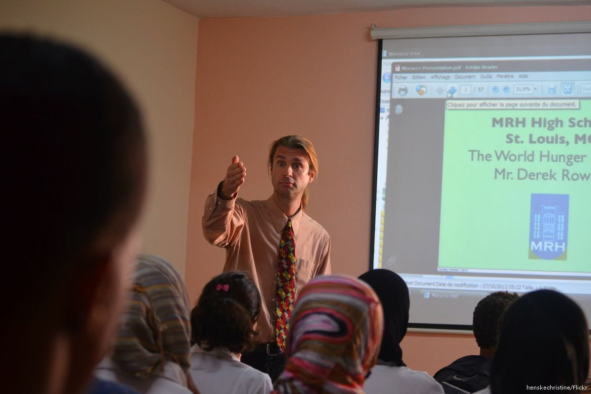 A teacher and his students in Casablanca, Morocco [henskechristine/Flickr]
