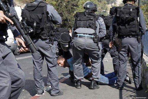 Israeli forces brutally arrest a Palestinian teenager, 21 November 2017 [Muammar Awad/Apaimages]