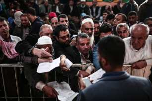 Palestinians wait for passport control at the Rafah border gate after the crossing was opened for 3 days under Palestinian Authority for the first time in 10 years on 18 November 2017 in Rafah, Gaza [Mustafa Hassona/Anadolu Agency]