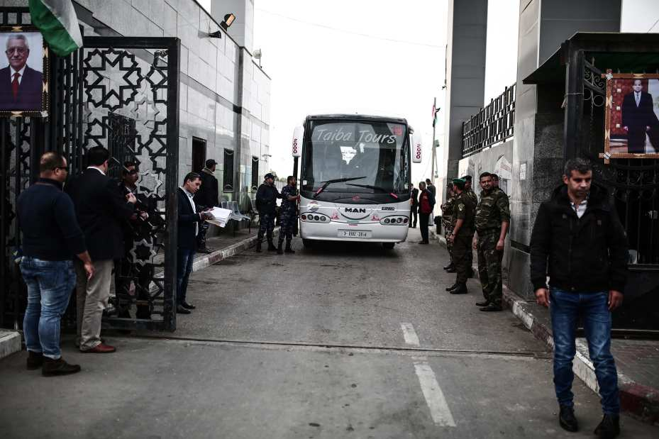Palestinians cross the Rafah border gate with busses after the crossing opened for 3 days under Palestinian Authority for the first time in 10 years on 18 November 2017 in Rafah, Gaza [Mustafa Hassona/Anadolu Agency]