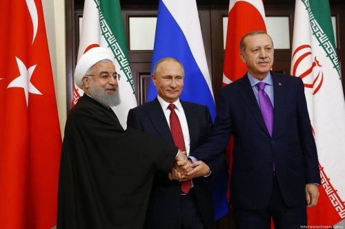 Turkish President Recep Tayyip Erdogan (R), Russian President Vladimir Putin (C) and Iranian President Hassan Rouhani (L) pose for a photo ahead of the trilateral summit to discuss progress on Syria, between the Presidents of Turkey, Russia and Iran on 22 November 2017 in Sochi, Russia . [Sefa Karacan/Anadolu Agency]