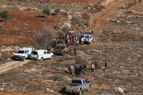 Palestinians react to Israeli soldiers after a Palestinian farmer shot dead by Jewish settlers, at the Khusra village of Nablus in West Bank on November 30, 2017. After that, Palestinians detained Jewish settlers in a cave and Israeli soldiers arrived at the scene and received these detained Jewish settlers. [Nedal Eshtayah /Anadolu Agency]