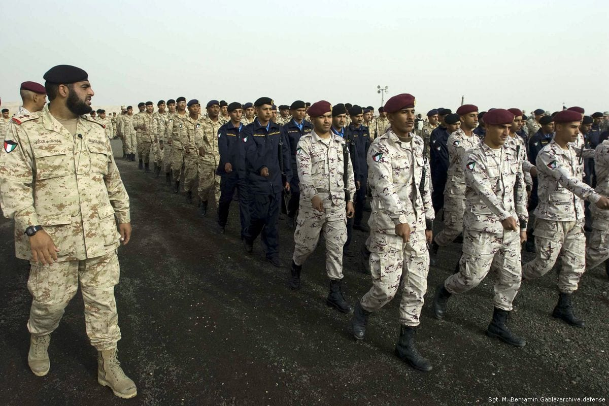 Kuwaiti soldiers at Camp Arifjan, Kuwait, march in formation on February 21, 2011 [Sgt. M. Benjamin Gable / US DoD]