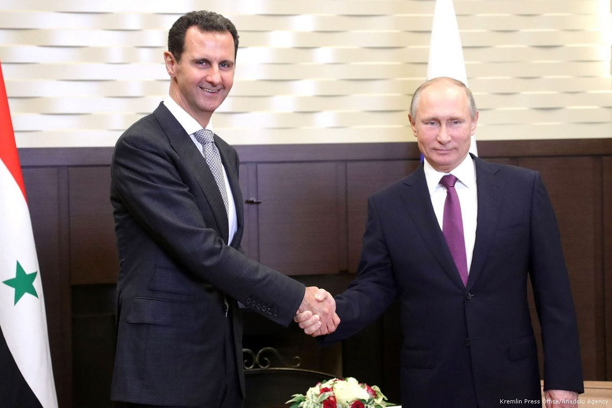 Russian President Vladimir Putin (R) shakes hands with Syrian President Bashar al-Assad (L) during their meeting in Sochi, Russia on 21 November 2017 [Kremlin Press Office/ Anadolu Agency]