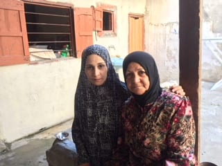 A family in Rashidieh, the largest Palestinian refugee camp in Tyre, Lebanon
