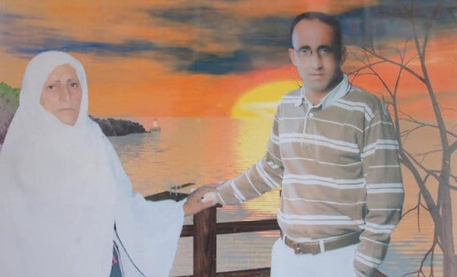 Kamal Al-Assar with his monther, Tamam Al-Assar, seen in a photo from the family album