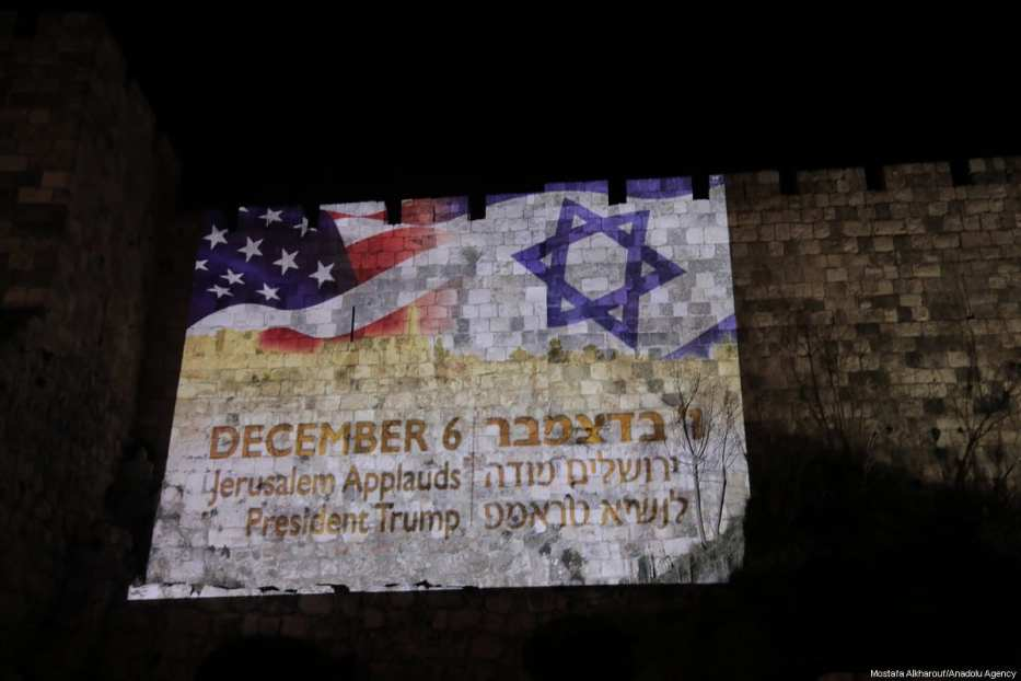 The flags of Israel and the US are reflected by Israeli authorities on western parts of the historical walls around the Old City of occupied Jerusalem to mark US President Donald Trump's speech regarding the recognition of Jerusalem as Israel's capital on December 6, 2017. [Mostafa Alkharouf/Anadolu Agency]