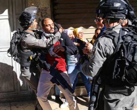 Israeli occupation forces arrest a Palestinian protester on 9 December 2017 in Jerusalem who stood in opposition of US President Donald Trump's decision to recognise Jerusalem as Israel's capital . [Salih Zeki Fazlıoğlu/Anadolu Agency]