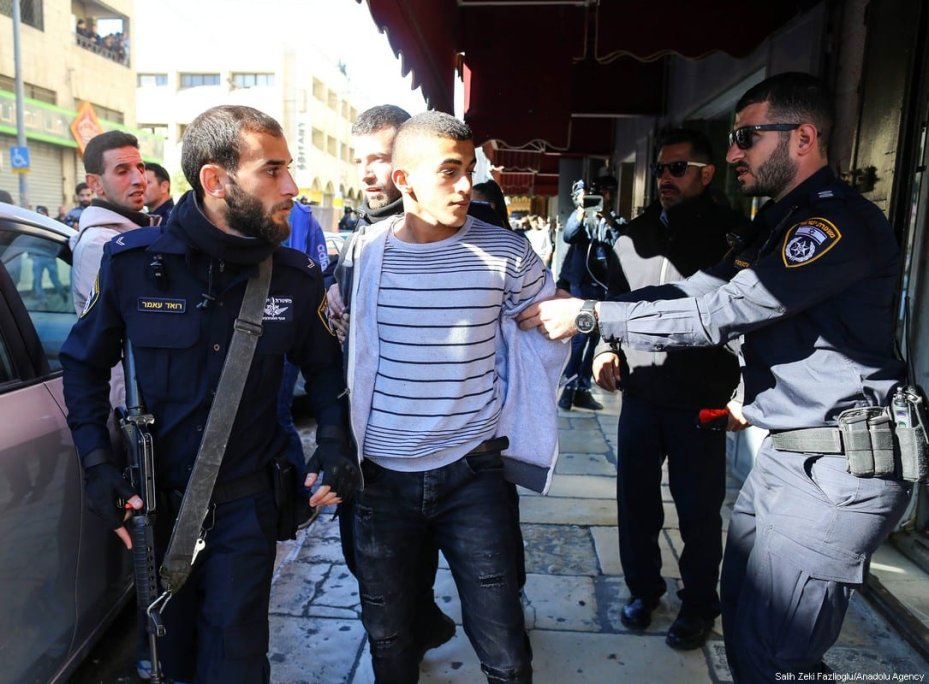 JERUSALEM - DECEMBER 9 : Israeli security forces take a demonstrator into custody during a protest against U.S. President Donald Trump's announcement to recognize Jerusalem as the capital of Israel and plans to relocate the U.S. Embassy from Tel Aviv to Jerusalem, on December 9, 2017 in East Jerusalem. ( Salih Zeki Fazlıoğlu - Anadolu Agency )