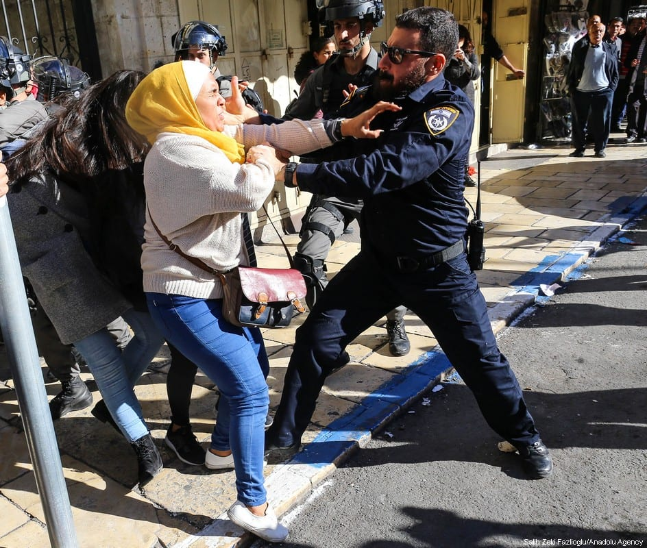 Israeli occupation forces arrest a Palestinian protester on 9 December 2017 in Jerusalem who stood in opposition of US President Donald Trump's decision to recognise Jerusalem as Israel's capital . [Salih Zeki Fazlıoğlu/Anadolu Agency]
