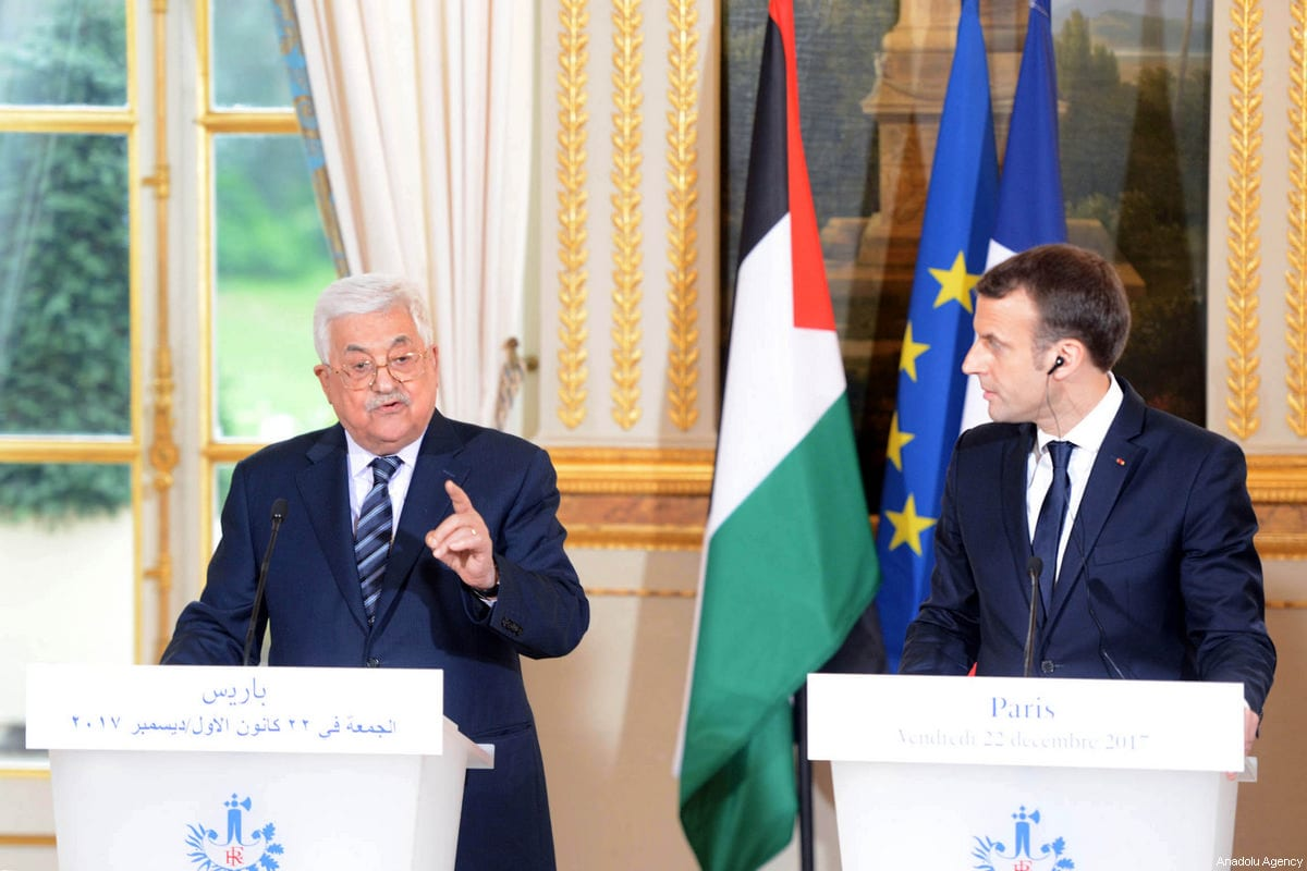 Palestinian President Mahmoud Abbas (L) and French President Emmanuel Macron (R) hold a press conference after an inter delegations meeting at the Elysee Palace in Paris, France on December 22, 2017 [Thaer Ghanaim / Palestinian Presidency / Handout - Anadolu Agency]