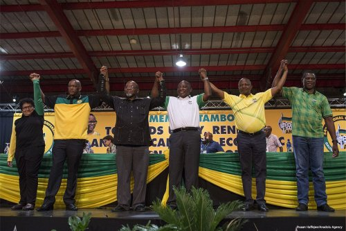 Cyril Ramaphosa (C) celebrates after he was elected as ANC's new party leader in Johannesburg, South Africa on 18 December 2017 [Ihsaan Haffejee/Anadolu Agency]