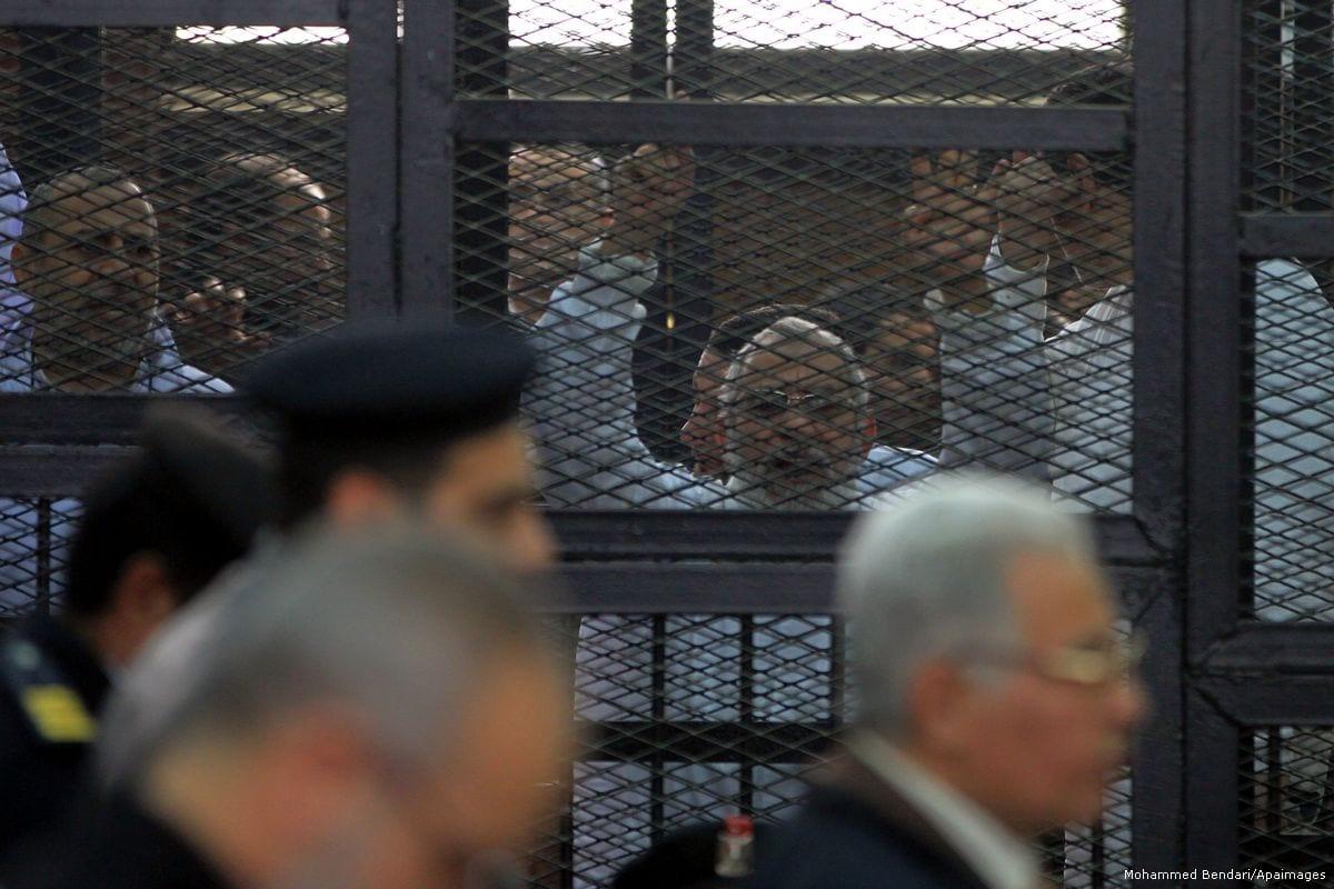 Egyptian members of Muslim Brotherhood, Mohamed Badie and Mohamed el-Beltagy during an initial court hearing [Mohammed Bendari/Apaimages]