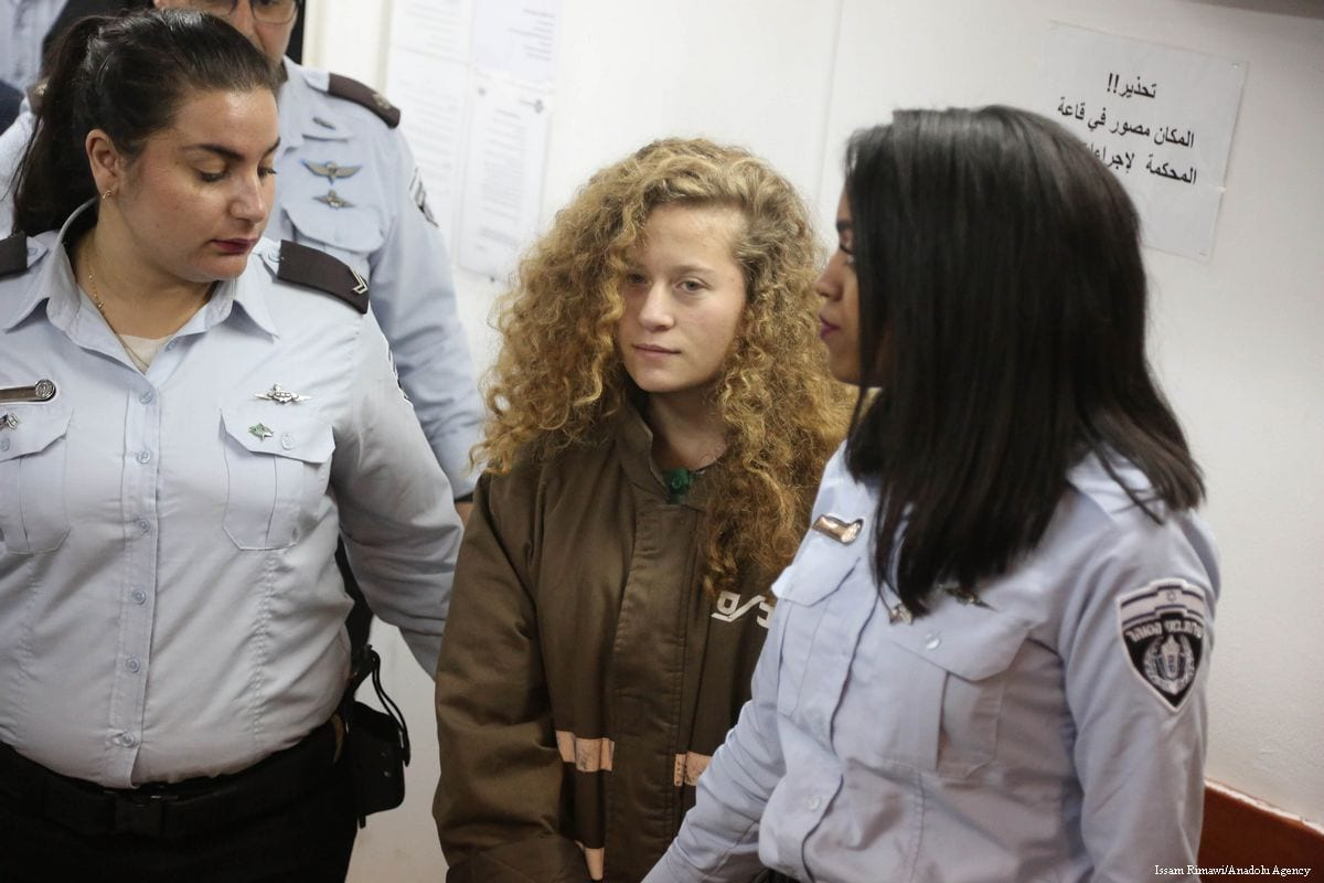 17-year-old Palestinian Ahed Al-Tamimi, appears in court after she was taken into custody by Israeli soldiers, in Ramallah, West Bank on 28th December 2017 [Issam Rimawi/Anadolu Agency] appears in court after she was taken into custody by Israeli soldiers, in Ramallah, West Bank on 28th December 2017 [Issam Rimawi/Anadolu Agency]