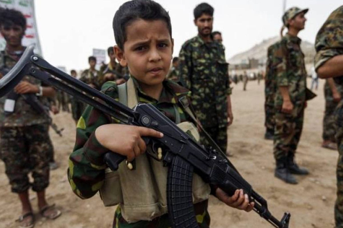 A Yemeni boy poses with a Kalashnikov assault rifle during a gathering of newly-recruited Houthi fighters in the capital Sanaa, to mobilise more fighters to battlefronts in the war against pro-government forces in several Yemeni cities, on July 16, 2017 [MOHAMMED HUWAIS/AFP/Getty Images]