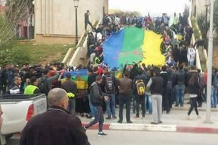 Algerian students can be seen protesting against the proposal to curb Berber language development