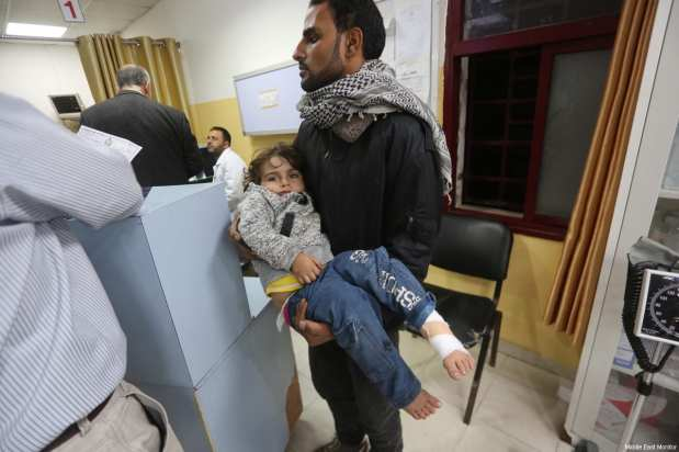Wounded Palestinians seen after Israeli occupation forces hit the wall surrounding the Indonesian Hospital in Gaza, during a F-16 air strike [Mohammed Asad / Middle East Monitor]
