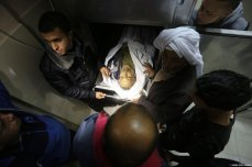 A dead Palestinian seen after Israeli occupation forces hit the wall surrounding the Indonesian Hospital in Gaza, during a F-16 air strike [Mohammed Asad / Middle East Monitor]