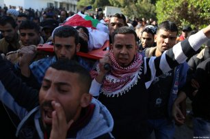 Funeral of Ibrahim Abu-Thurayya, 29, killed by an Israeli sniper during a protest by Palestinians against Trump's announcement on Jerusalem, which was met with violent Israeli dispersal tactics at the Gaza-Israel border, on Friday, December 15, 2017 [Mohammad Asad / Middle East Monitor]