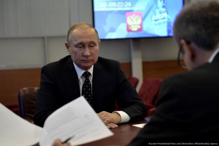 Putin and his three associates